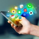 35147112 – hand holding smartphone with colorful app icons concept