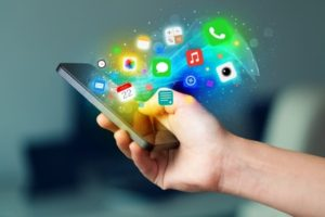 35147112 - hand holding smartphone with colorful app icons concept